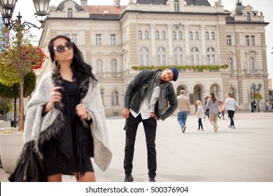 Handsome guy look at the hot girl on the street