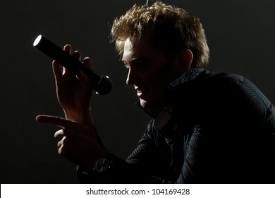 handsome guy with microphone in hands