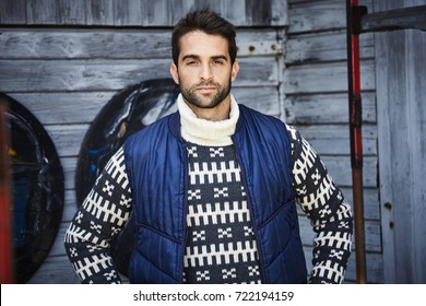 Handsome guy in sweater and body warmer, portrait