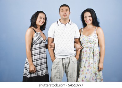 Handsome guy with two beautiful models woman posing in a fashion style