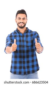 Handsome happy beard young man smiling and thumbs up, guy wearing blue caro shirt and jeans, isolated on white background