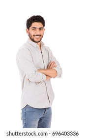Handsome happy beard young man smiling and standing confidently, guy wearing gray shirt and jeans, isolated on white background