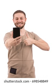 Handsome happy beard young man thumbs up and taking selfie, guy wearing beige t-shirt and jeans, isolated on white background