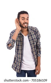 Handsome happy beard young man smiling and trying to hear a voice, guy wearing caro shirt and jeans, isolated on white background
