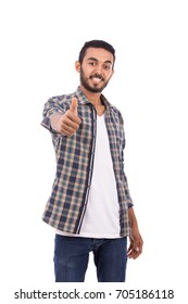 Handsome happy beard young man smiling and thumbs up, guy wearing caro shirt and jeans, isolated on white background