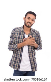 Handsome happy beard young man smiling and feeling love, guy wearing caro shirt and jeans, isolated on white background