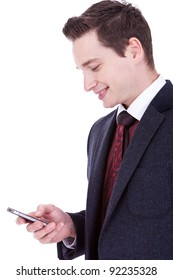 Handsome happy business man reading an SMS on cellphone against white