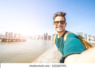 Handsome happy man smiling at the camera taking a selfie at NYC
