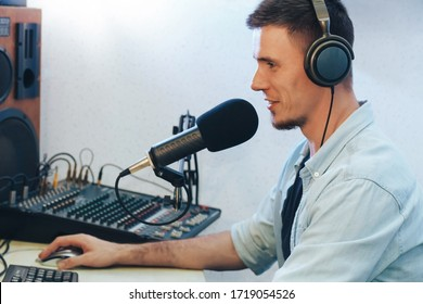 Handsome happy radio host moderating in studio