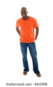 Handsome, happy, smiling man in a casual outfit of orange t-shirt, blue jeans, and sandals.