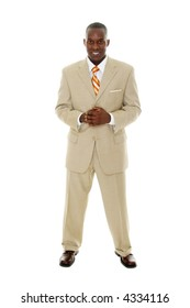 Handsome happy smiling man in tan business suit standing with hands clasped together.