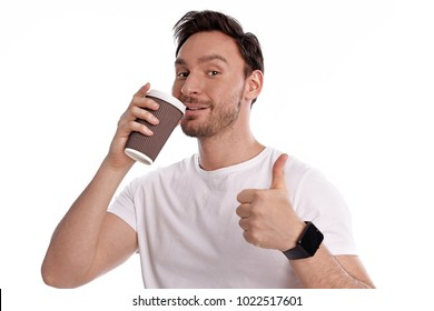 Handsome and healthy young man drinks coffee and enjoys it isolated on a white background