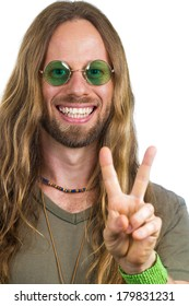 Handsome hippie wearing round green sunglasses doing a peace sign