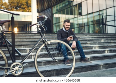 Handsome hipster browsing the net during a coffee break.