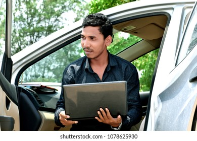 Handsome hipster businessman working with laptop and Sitting in The Car