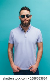 Handsome hipster guy with beard wearing blue t-shirt with a collar with space for your brand name or label. Mockup for print.