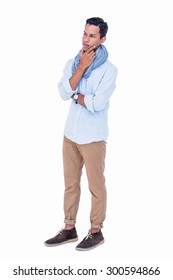 Handsome hipster looking away with hand on chin on white background