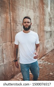 Handsome hipster man with beard wearing white blank t-shirt. white t shirt mockup.