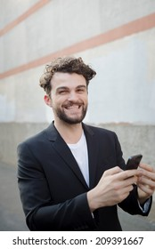 handsome hipster modern man using smart phone in the city