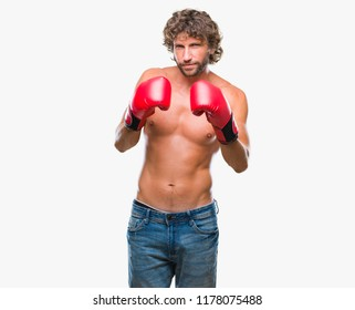 Handsome hispanic boxer man wearing boxing gloves over isolated background skeptic and nervous, frowning upset because of problem. Negative person.