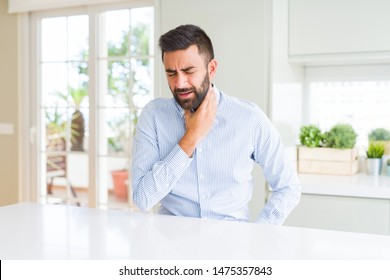 Handsome hispanic business man Touching painful neck, sore throat for flu, clod and infection