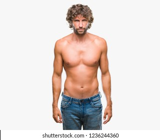 Handsome hispanic model man sexy and shirtless over isolated background skeptic and nervous, frowning upset because of problem. Negative person.