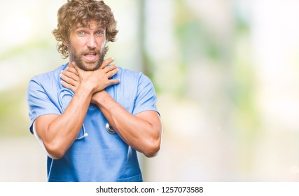 Handsome hispanic surgeon doctor man over isolated background shouting and suffocate because painful strangle. Health problem. Asphyxiate and suicide concept.