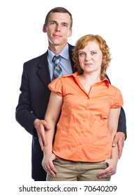 a handsome husband embraces his attractive wife. isolated on a white background
