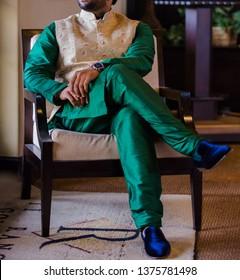 Handsome Indian Groom Wears Green Kurta and Pajama With Off White Waistcoat.