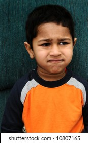 An handsome Indian kid looking very disappointed