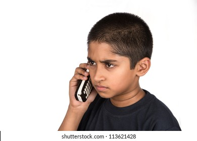 Handsome Indian kid looking very mad talking on phone