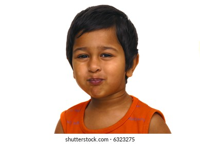 An handsome indian kid playing pranky face