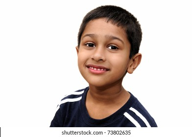 an handsome indian kid smiling for you