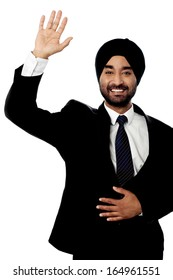 Handsome Indian male manager waving