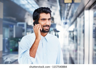 Handsome Indian man calling on phone in  metro