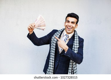 Handsome indian man showing a lot of money