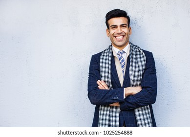 Handsome indian man standing against the wall