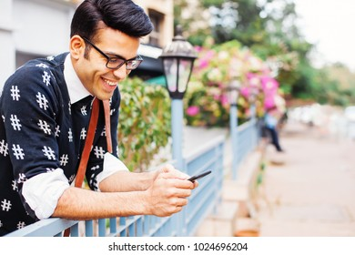 Handsome Indian man using mobile phone