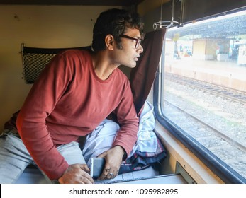 Handsome indian man wearing eyes glasses travelling on train