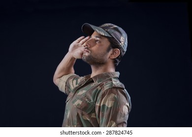 Handsome Indian soldier saluting