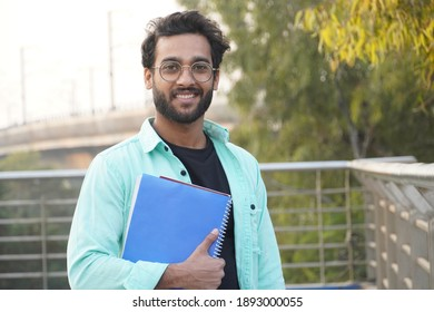 Handsome Indian Young Collage student with book closeup
