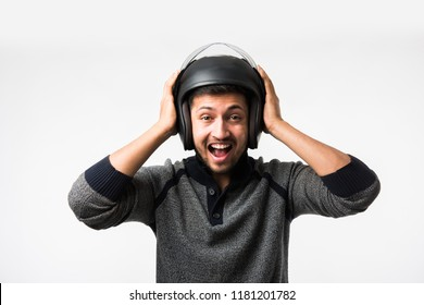 Handsome Indian/asian man in helmet over white background with different expressions