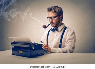 handsome journalist writing with typewriter
