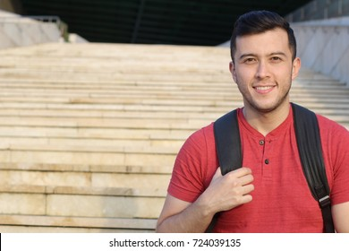 Handsome joyful mixed race person heading to school with copy space for text