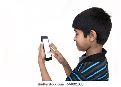 a handsome kid addicted to his cell phone