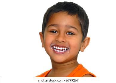 An handsome kid happy after drinking milk