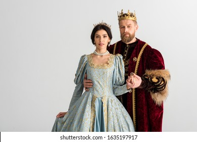 handsome king hugging queen with crown isolated on grey