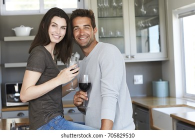 Handsome kitchen couple posing for camera, portrait