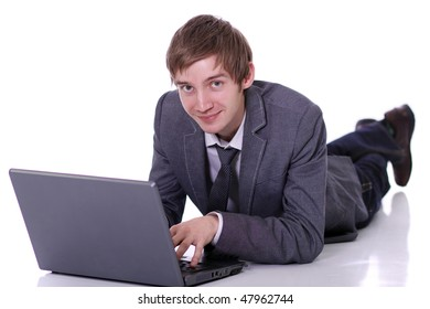 Handsome laptop man laying on the floor
