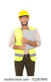 Handsome latin engineer, young man wearing yellow vest and helmet, isolated on white background